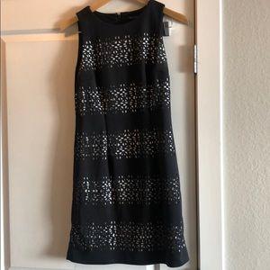 Sleeveless black dress with back zipper